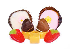 Heart shaped chocolates and sweets on white stock photos