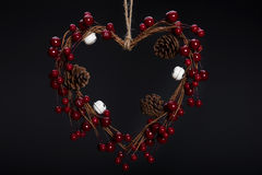 Heart shaped Christmas decoration with pine cones Stock Photography