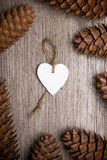 Heart shaped Christmas decoration and spruce cones Stock Image