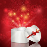 Heart shaped christmas gift box. Heart shaped gift box background on bokeh lights background Stock Photos