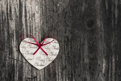 Heart shaped Christmas ornament on a rustic wood background Royalty Free Stock Image