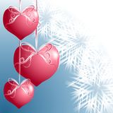 Heart Shaped Christmas Ornaments. A clip art illustration featuring a group of pink heart shaped ornaments hanging with ribbons set against blue and white Stock Photos