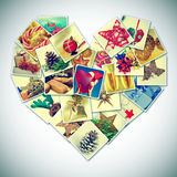 Heart-shaped christmas pictures collage. A collage of different pictures of christmas items forming a heart, with a retro effect Stock Photos