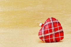 Heart shaped Christmas tree decoration on golden background Stock Image