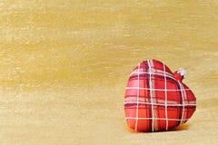 Heart shaped Christmas tree decoration on golden background Royalty Free Stock Photo