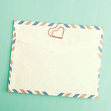 Heart shaped clips and envelope Royalty Free Stock Photos