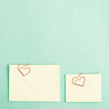 Heart shaped clips and envelopes Stock Images