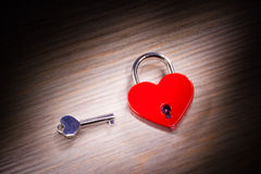 Heart shaped closed lock. On wooden background Royalty Free Stock Image