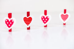 Heart shaped clothes pegs stock images