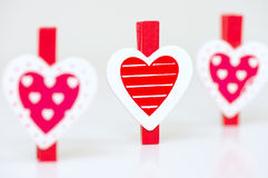 Heart shaped clothes pegs royalty free stock photography
