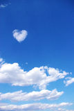 Heart shaped cloud and blue sky. A shot of blue sky and heart shaped white cloud Royalty Free Stock Images