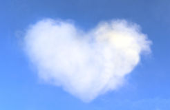 Heart shaped cloud in the blue sky Royalty Free Stock Photo