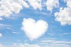 Heart shaped cloud on blue sky Stock Image