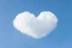 Heart shaped cloud in the blue sky. Royalty Free Stock Photo