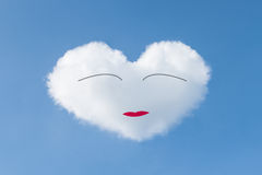 Heart shaped cloud in the blue sky. Stock Image