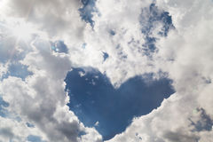 Heart shaped cloud formation with blue sky Stock Images