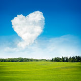 Heart Shaped Cloud and Green Field Landscape. Summer Blue Sky with Copy Space. Love and Valentine's Day Concept Stock Photography