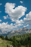 Heart-shaped cloud in the mountains Royalty Free Stock Photo