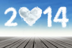 Heart shaped cloud of new year 2014. On the blue sky Royalty Free Stock Photos