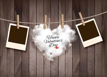 Heart shaped cloud on rope and photos. Stock Photos