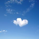 Heart shaped clouds. Two side by side heart shaped clouds stock photography