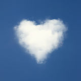 Heart shaped clouds on blue sky. Stock Photo