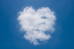 Heart shaped clouds on the blue sky. Royalty Free Stock Images