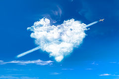 Heart shaped clouds in blue sky Stock Images