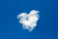Heart shaped clouds in deep blue sky Royalty Free Stock Images
