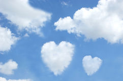 Heart shaped clouds in the sky. Clouds in the shape of hearts in a blue sky Stock Image