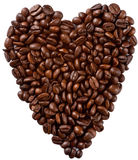 Heart Shaped Coffee. Coffee beans heart shaped and isolated in a white background Royalty Free Stock Photos
