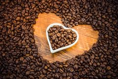 Coffee beans and white plates Stock Photos