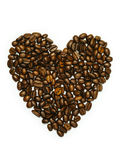 Heart-shaped coffee beans. Photo of coffee beans in heart shape isolated over white background Royalty Free Stock Photography