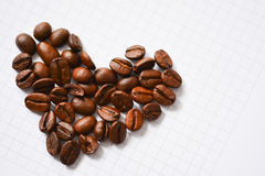 Heart shaped coffee beans suggesting coffee addiction Royalty Free Stock Photos