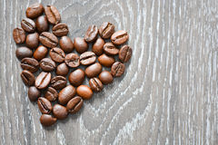Heart shaped coffee beans suggesting coffee addiction Royalty Free Stock Image