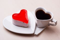 Heart shaped coffee cup and cake Royalty Free Stock Photo