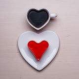 Heart shaped coffee cup and cake Royalty Free Stock Image