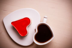 Heart shaped coffee cup and cake Stock Images