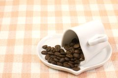 Heart shaped coffee cup and coffee beans Stock Image