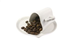 Heart shaped coffee cup and coffee beans Stock Photo