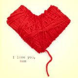 Heart-shaped coil of red yarn and text I love you, mom Stock Image