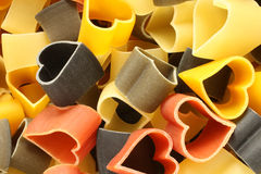 Heart-shaped colored Italian pasta Royalty Free Stock Photography