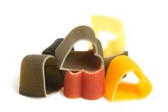 Heart-shaped colored Italian pasta Stock Photography