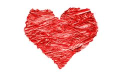 Heart shaped colorful bright red compressed wood chippings plywood with jagged rough edges. And isolated on a white background stock photo