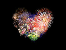 Heart shaped colorful fireworks. In the night Stock Photo