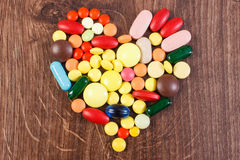 Heart shaped colorful medical pills and capsules, health care concept. Heart shaped colorful medical pills, capsules or supplements for therapy, concept of royalty free stock photos