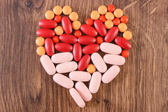 Heart shaped colorful medical pills and capsules, health care concept Royalty Free Stock Photo