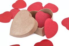 heart-shaped box and red confetti Stock Photos