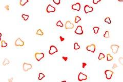 Heart-shaped confetti on white background stock image