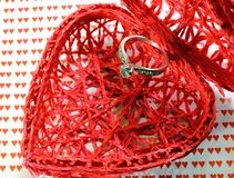 Heart-shaped container and a big diamond ring Stock Photography
